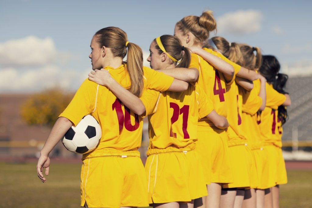 Players from a young soccer club are united with one purpose: Teamwork.